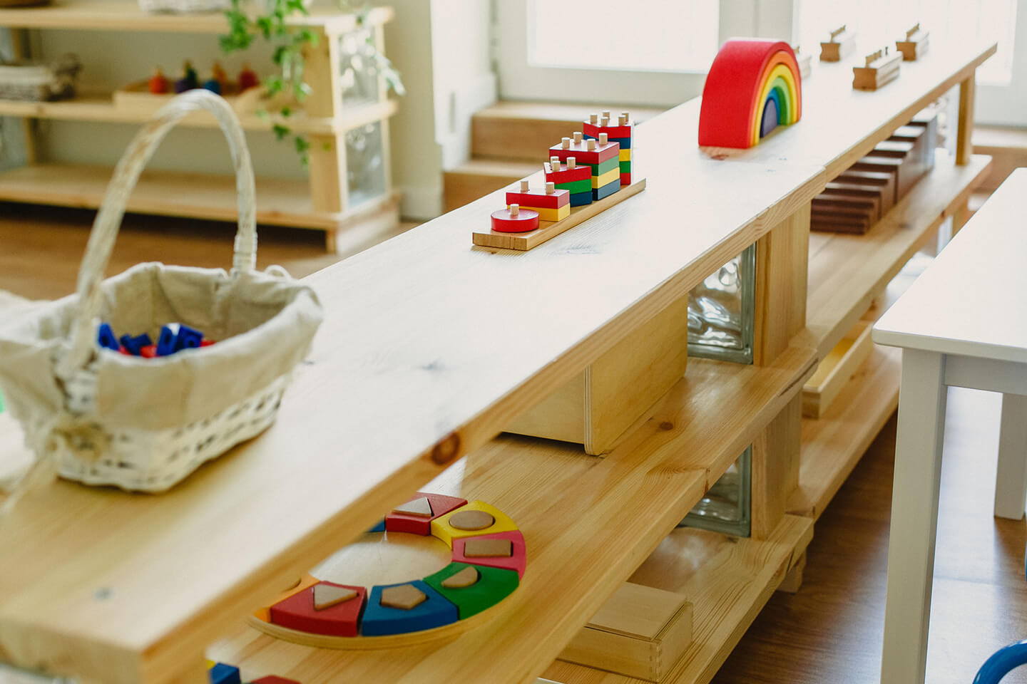 A wooden shelf with toys on it at a childcare center in Sydney's Inner West